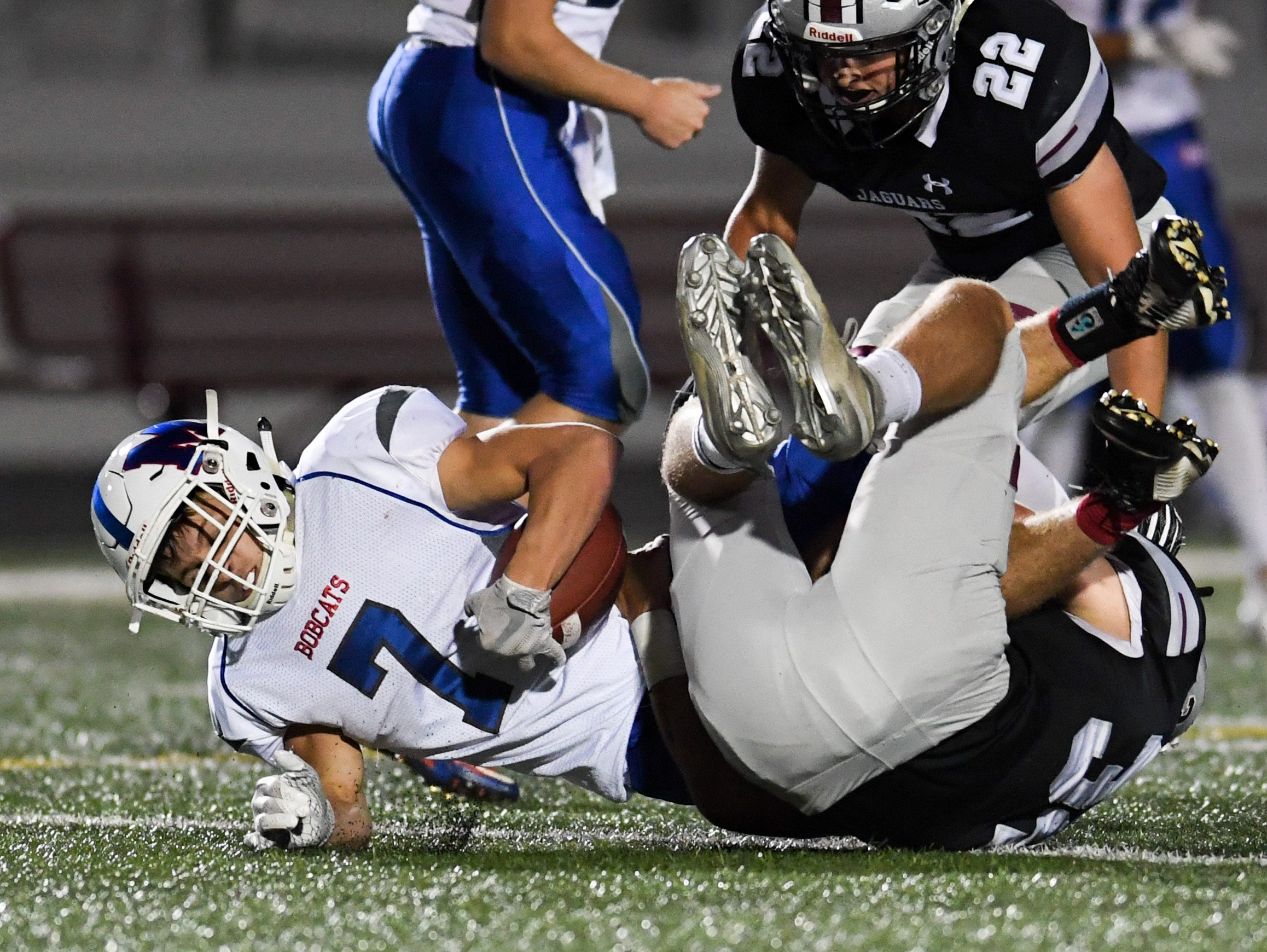 Ankeny Centennial's Gabe Godwin (32)  tackles Marshalltown Quarterback Jacob Smith (5) on Friday, Sept. 21, 2018 during a football game between the Ankeny Centennial Jaguars and the Marshalltown Bobcats at Northview Middle School.