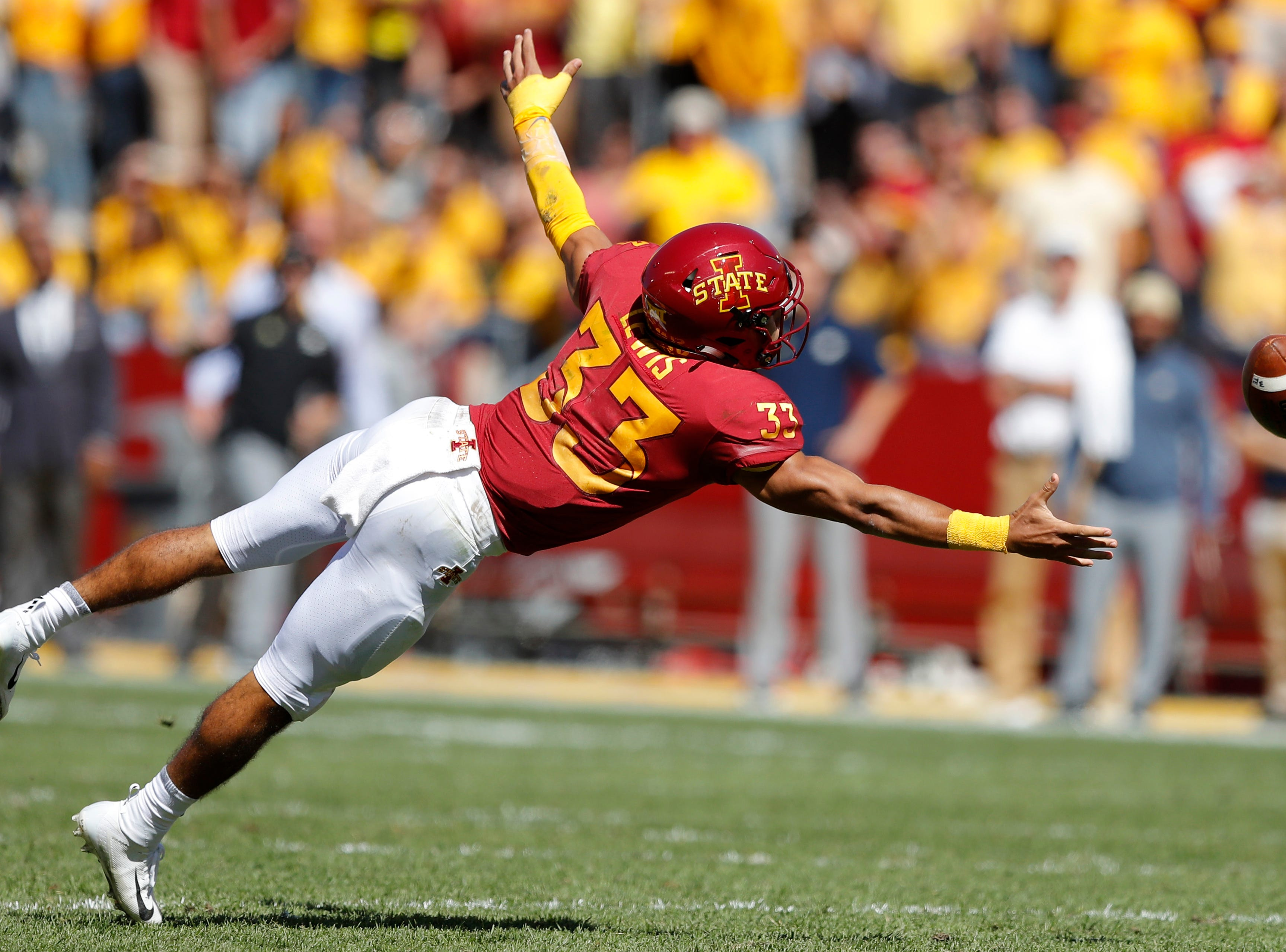 Iowa State defensive back Braxton Lewis makes a diving attempt for an interception during the second half of an NCAA college football game against Akron, Saturday, Sept. 22, 2018, in Ames, Iowa. The pass fell incomplete. Iowa State won 26-13. (AP Photo/Charlie Neibergall)