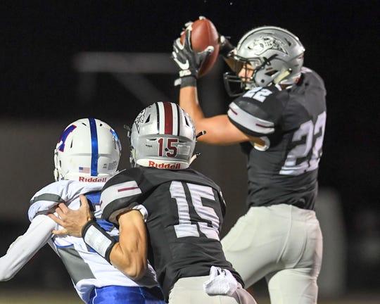 Ankeny Centennial's Kaden Bollwinkel (22) intercepts a pass on Friday, Sept. 21, 2018 during a football game between the Ankeny Centennial Jaguars and the Marshalltown Bobcats at Northview Middle School.