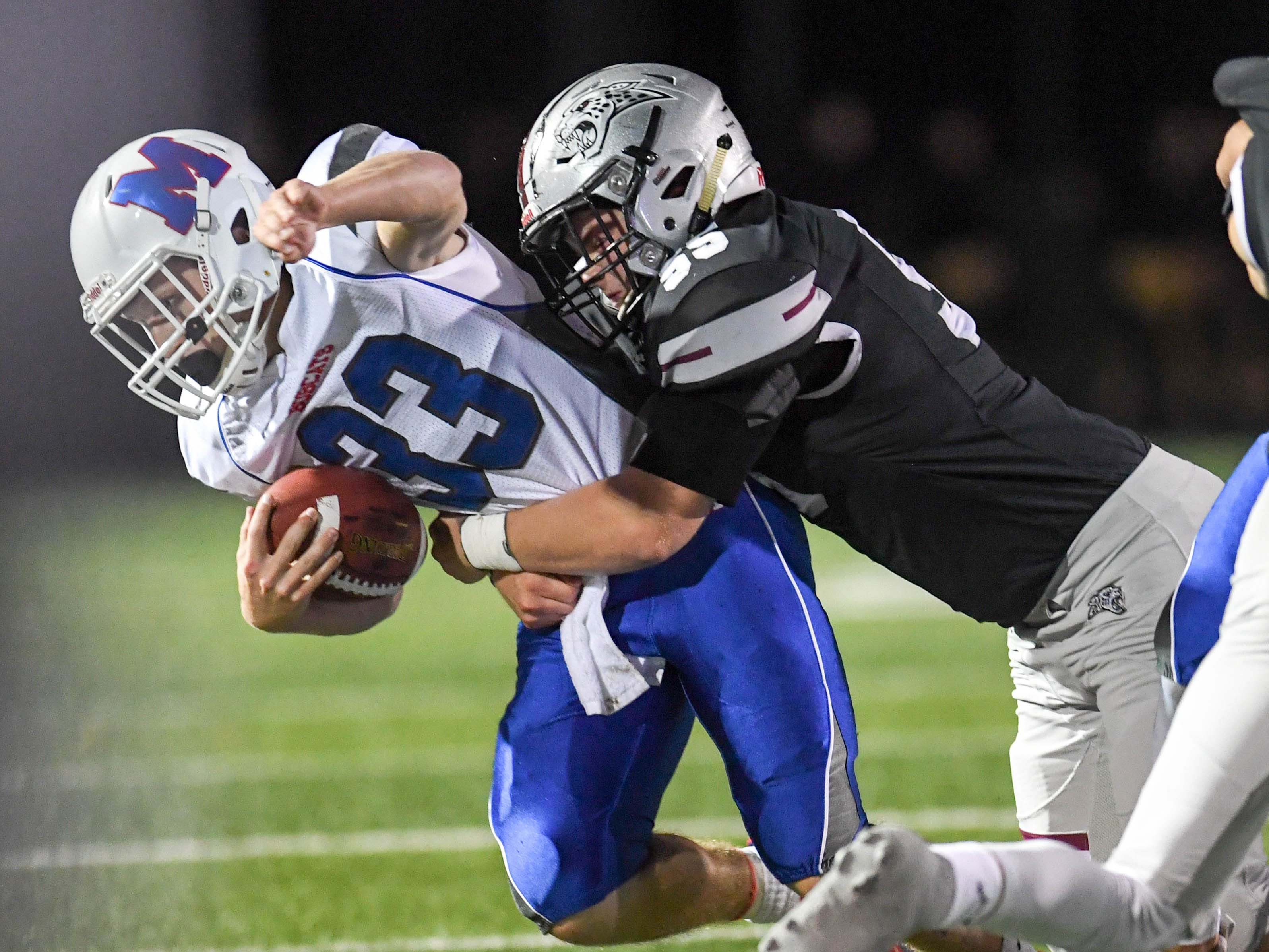 Ankeny Centennial's Ethan Frazier (55) tackles Marshalltown's Giorgio Dilorio (33) on Friday, Sept. 21, 2018 during a football game between the Ankeny Centennial Jaguars and the Marshalltown Bobcats at Northview Middle School.