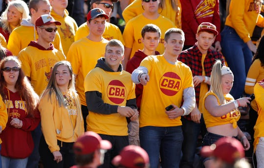 "Iowa State students wear yellow shirts with ""CBA"" to honor slain student Celia Barquin Arozamena before an NCAA college football game between Iowa State and Akron, Saturday, Sept. 22, 2018, in Ames, Iowa. Barquin, who was the 2018 Big 12 women's golf champion and Iowa State Female Athlete of the Year, was found Monday morning in a pond at a golf course near the Iowa State campus."