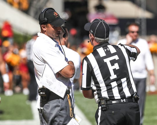 Sep 22, 2018; Ames, IA, USA; Iowa State Cyclones head coach Matt Campbell  talks with an official between quarters during their game the Akron Zips Jack Trice Stadium. The Cyclones beat the Zips 26 to 13.