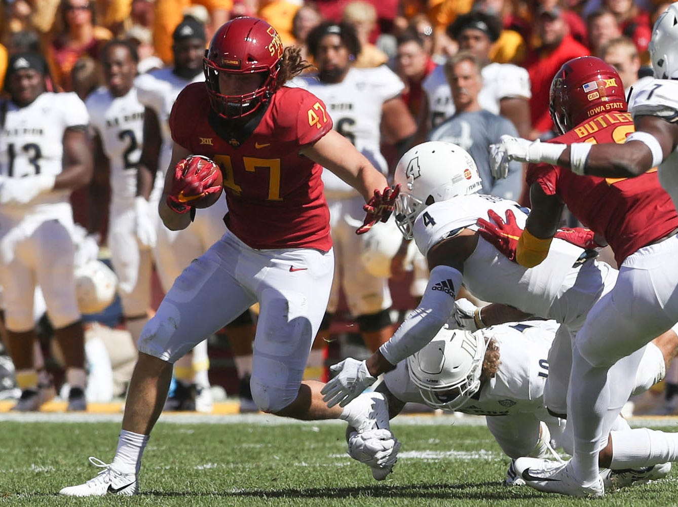 Sep 22, 2018; Ames, IA, USA; Iowa State Cyclones tight end Sam Seonbuchner (47) runs away from Akron Zips cornerback Kyron Brown (4) at Jack Trice Stadium.