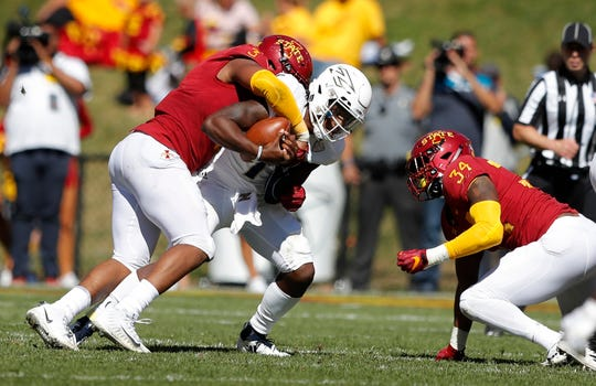 Akron quarterback Kato Nelson, center, is sacked by Iowa State defensive end JaQuan Bailey, left, and linebacker O'Rien Vance, right, during the second half of an NCAA college football game, Saturday, Sept. 22, 2018, in Ames, Iowa. Iowa State won 26-13.