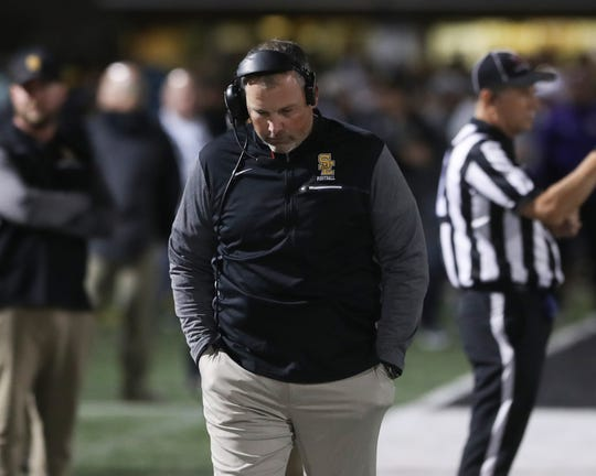 Southeast Polk Rams head coach Brad Zelenovich hangs his head afterhis Rams lost to the Fort Dodge Dodgers on the final play of the game at Ram Stadium.