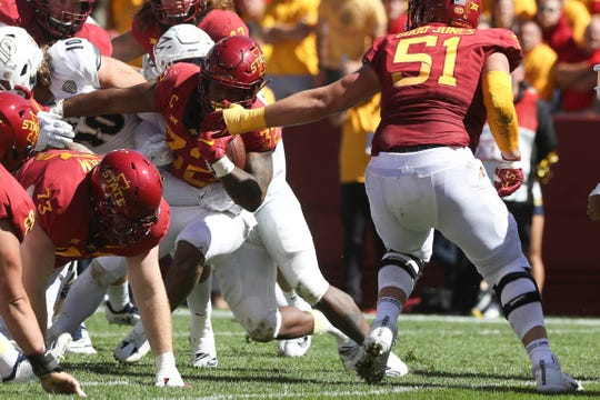 Iowa State offensive lineman Julian Good-Jones (51) tries to pull Iowa State Cyclones running back David Montgomery (32) in the end zone against Akron Zips last Saturday.