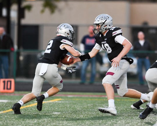 Ankeny Centennial Quarterback Garret Severseike (18) hands off to Avery Gates (2) on Friday, Sept. 21, 2018 during a football game between the Ankeny Centennial Jaguars and the Marshalltown Bobcats at Northview Middle School.