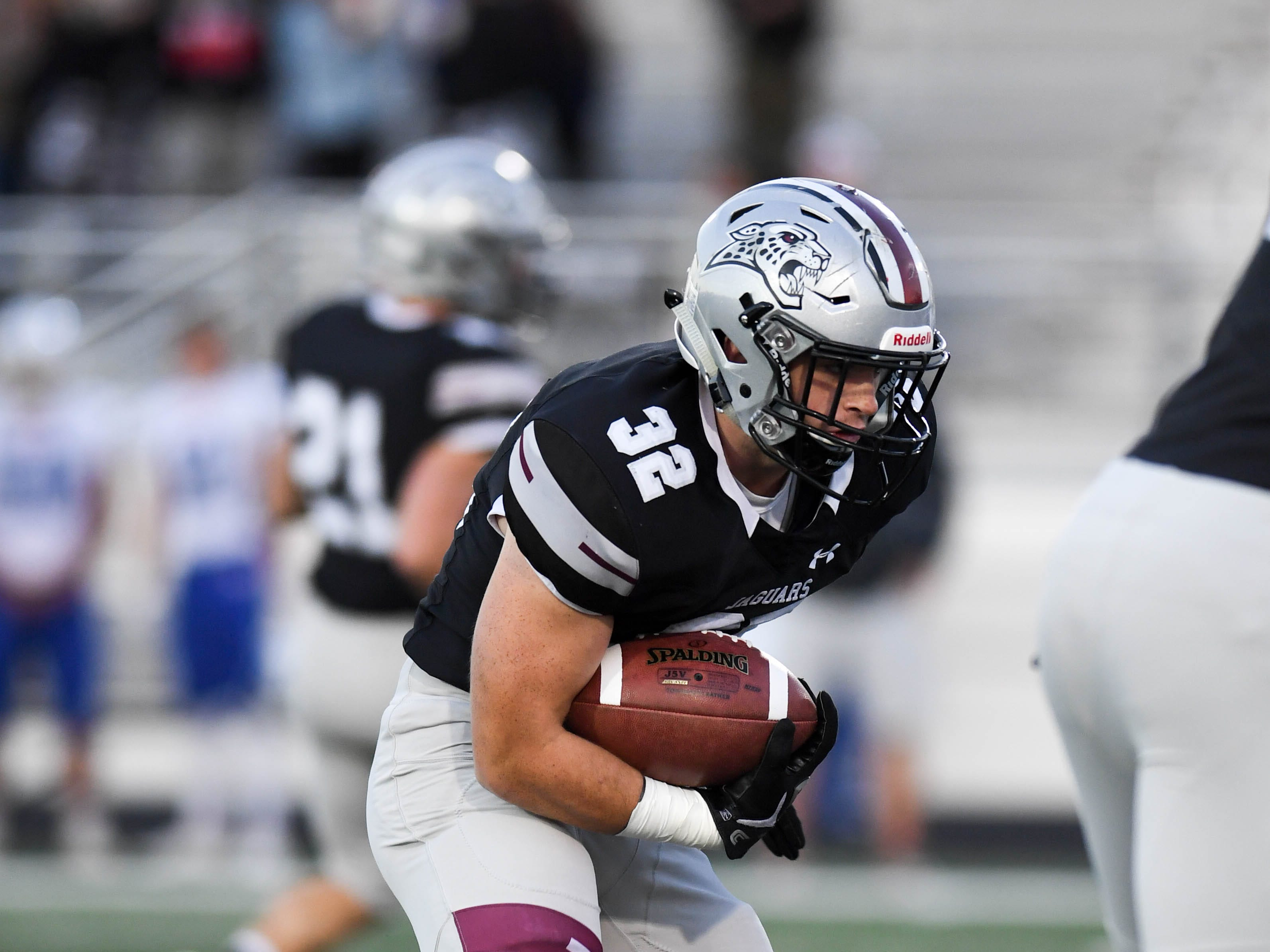 Ankeny Centennial's Gabe Godwin (32) looks for a running lane on Friday, Sept. 21, 2018 during a football game between the Ankeny Centennial Jaguars and the Marshalltown Bobcats at Northview Middle School.