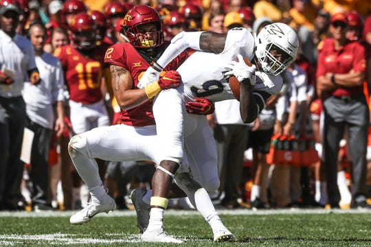 Sep 22, 2018; Ames, IA, USA; Iowa State Cyclones defensive back Greg Eisworth (12) tackles Akron Zips wide receiver Jonah Morris (9) at Jack Trice Stadium. The Cyclones beat the Zips 26 to 13.