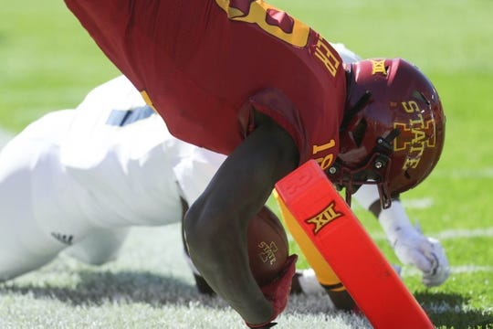 Sep 22, 2018; Ames, IA, USA; Iowa State Cyclones wide receiver Hakeem Butler (18) scores a touchdown against the Akron Zips at Jack Trice Stadium.