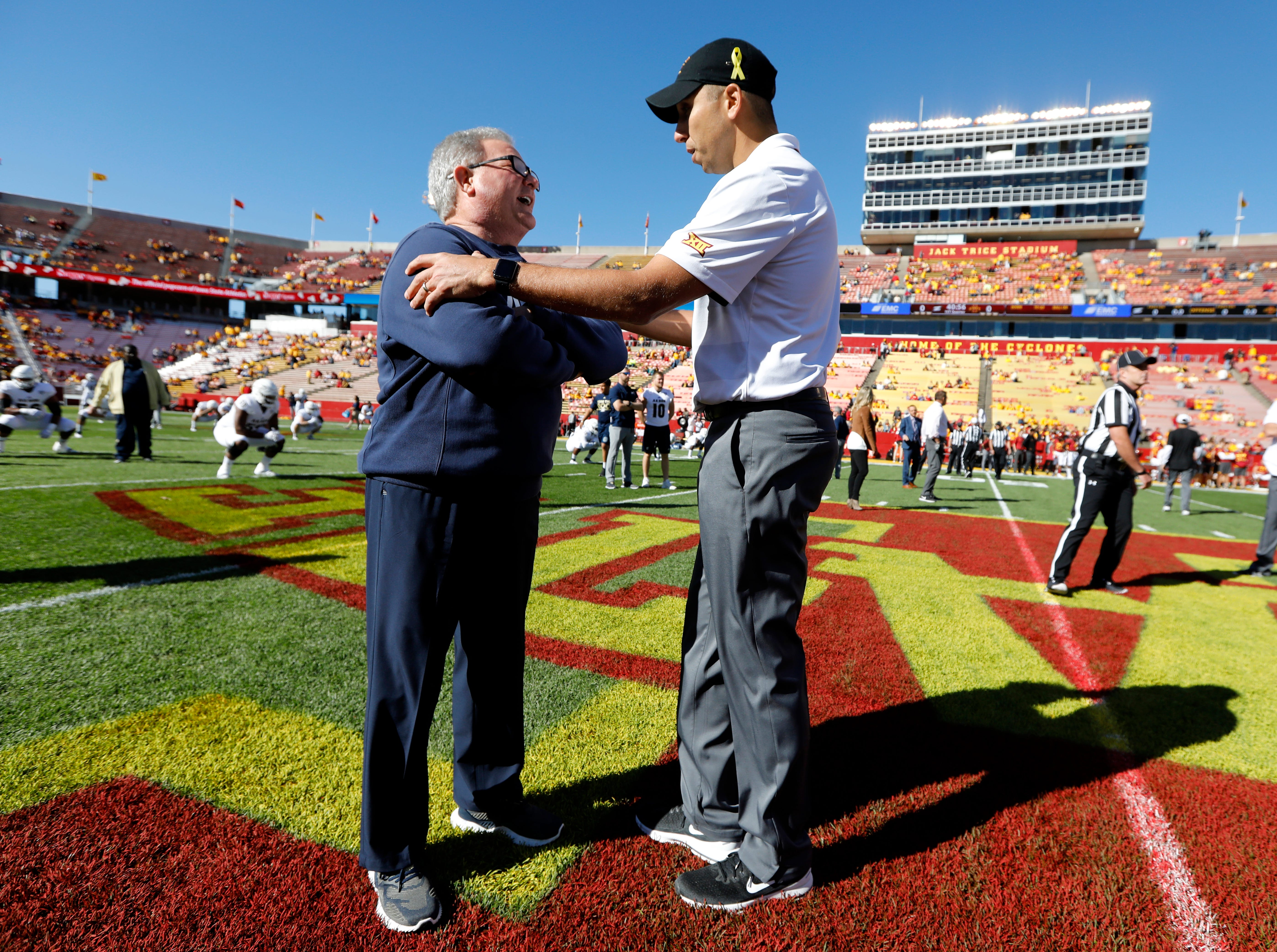 Akron head coach Terry Bowden, left, talks with Iowa State head coach Matt Campbell before an NCAA college football game, Saturday, Sept. 22, 2018, in Ames, Iowa.