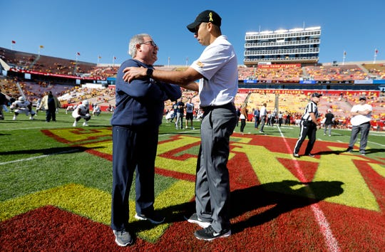 Akron head coach Terry Bowden, left, talks with Iowa State head coach Matt Campbell before a 2018 NCAA college football game in Ames.