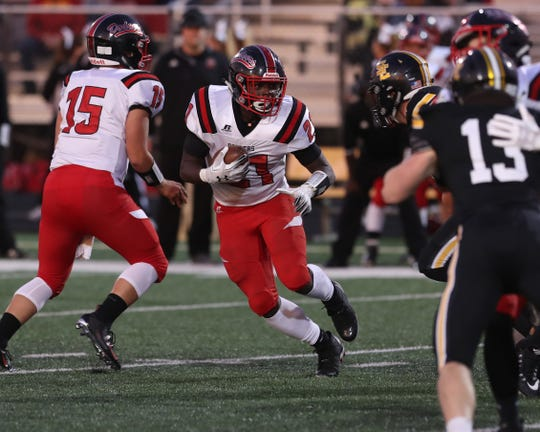 Fort Dodge Dodgers Dayson Clayton (21) looks for running room against the Southeast Polk Rams.