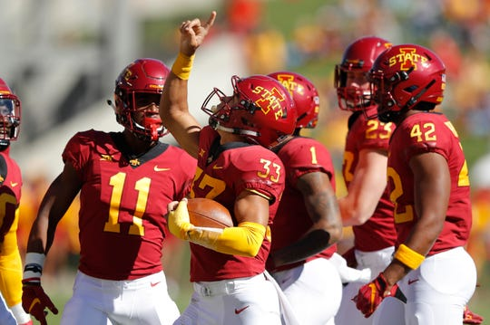 Iowa State defensive back Braxton Lewis (33) celebrates with teammates after intercepting a pass during the first half of an NCAA college football game against Akron, Saturday, Sept. 22, 2018, in Ames, Iowa.
