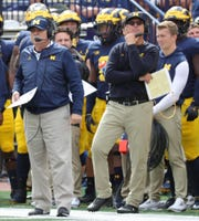 Michigan defensive coordinator Don Brown, left, and head coach Jim Harbaugh.