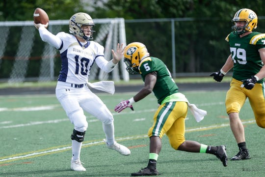 Rochester Hills Stony Creek quarterback Frank Potenza (10) throws against Farmington Hills Harrison during a game at Harrison High School in Farmington Hills, Friday, September 21, 2018.