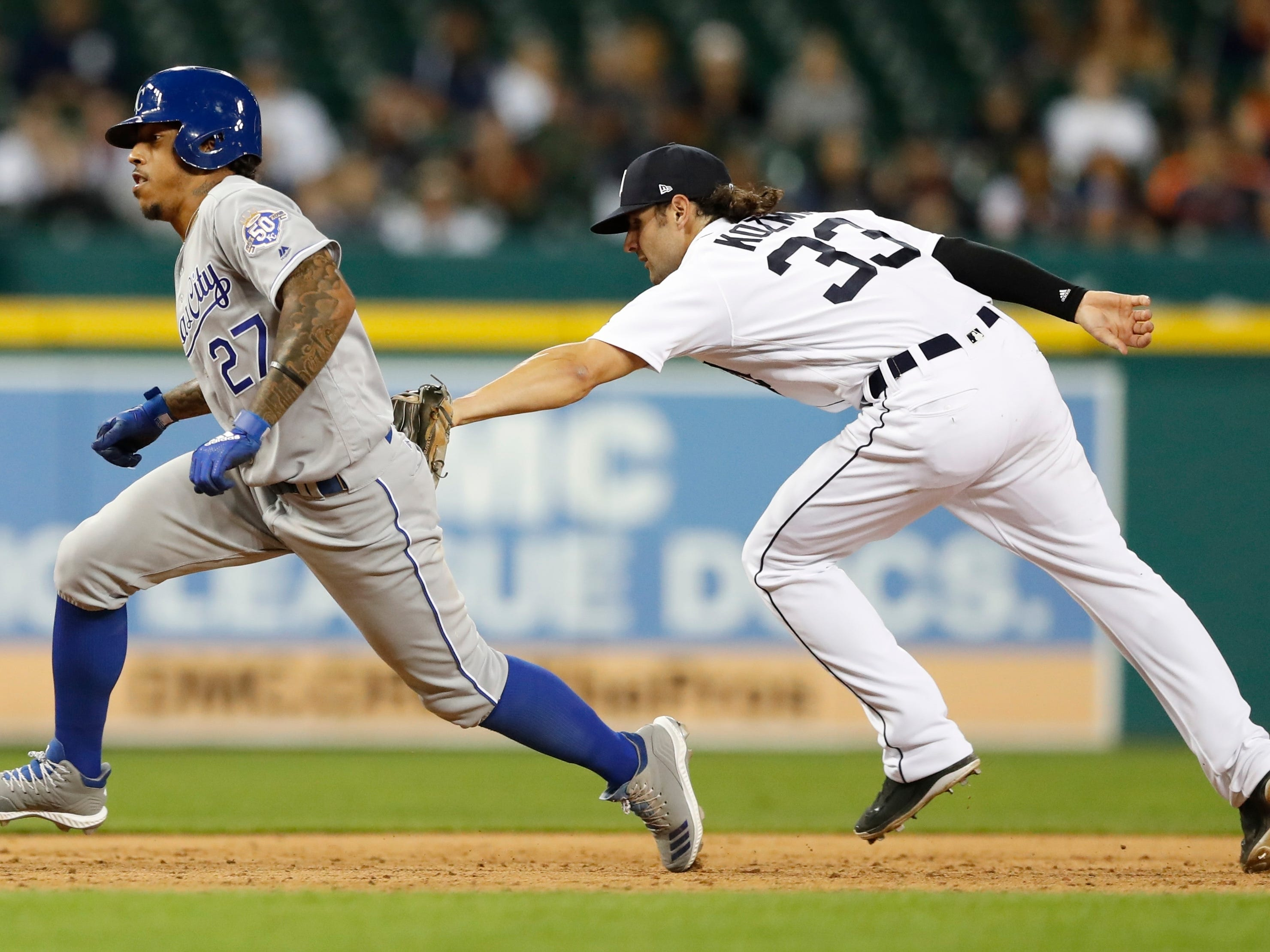 Kansas City Royals' Adalberto Mondesi is caught in a rundown by Detroit Tigers shortstop Pete Kozma during the ninth inning Friday, Sept. 21, 2018, in Detroit.