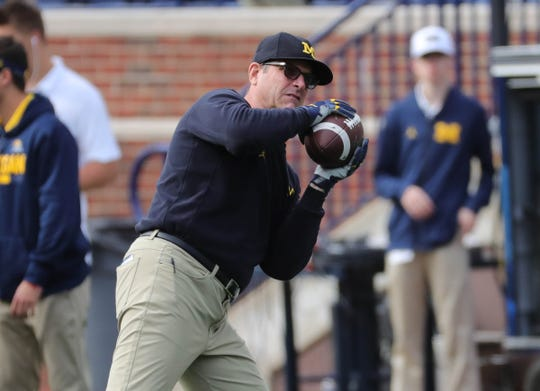 Michigan head coach Jim Harbaugh on the field before action against Nebraska, Sept. 22, 2018 at Michigan Stadium in Ann Arbor.