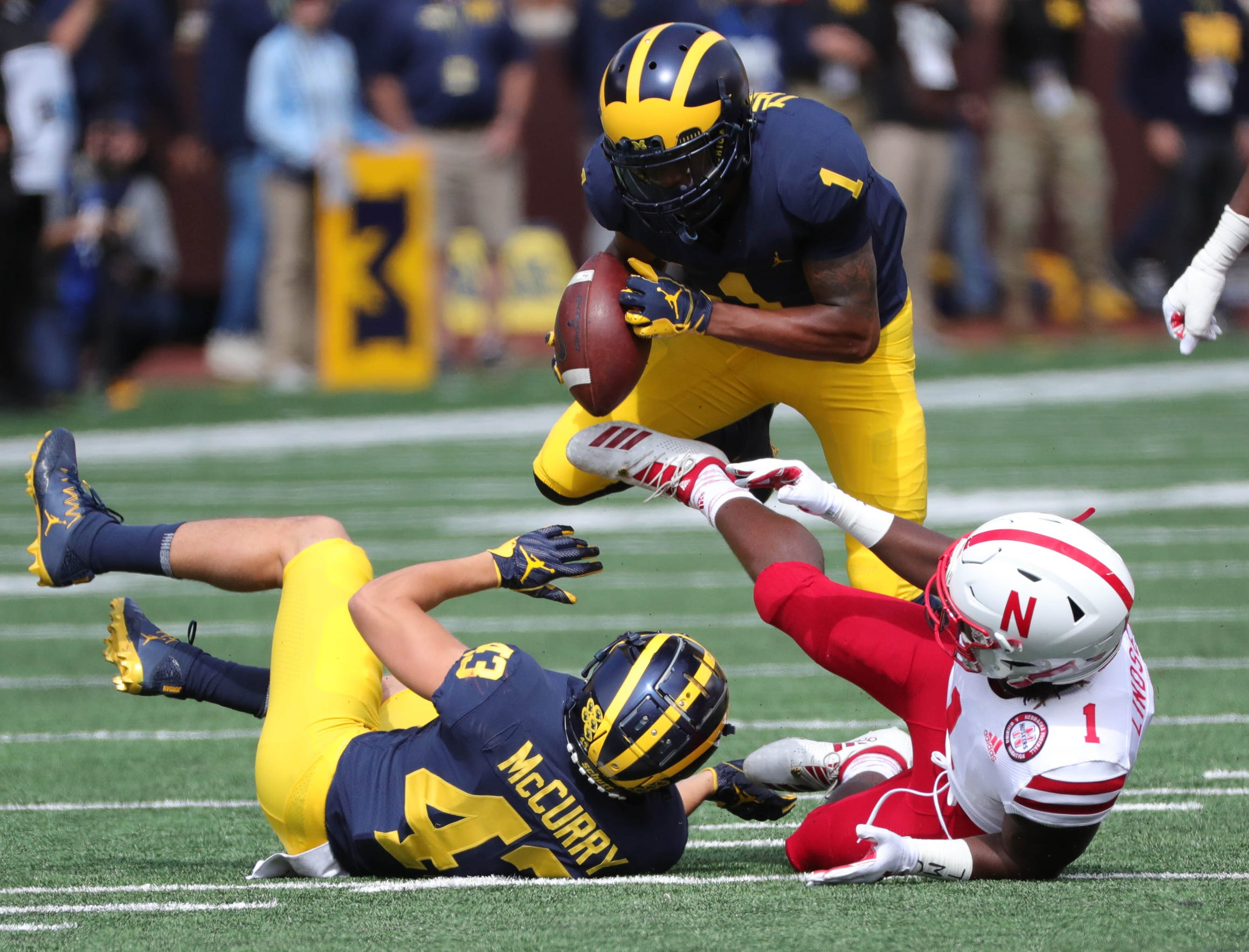Michigan defensive back Ambry Thomas recovers a fumble against Nebraska.