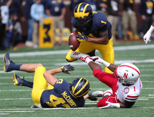 Michigan defensive back Ambry Thomas recovers a fumble by Nebraska receiver Tyjon Lindsey during U-M's 56-10 win over Nebraska on Saturday, Sept. 22, 2018, at Michigan Stadium.