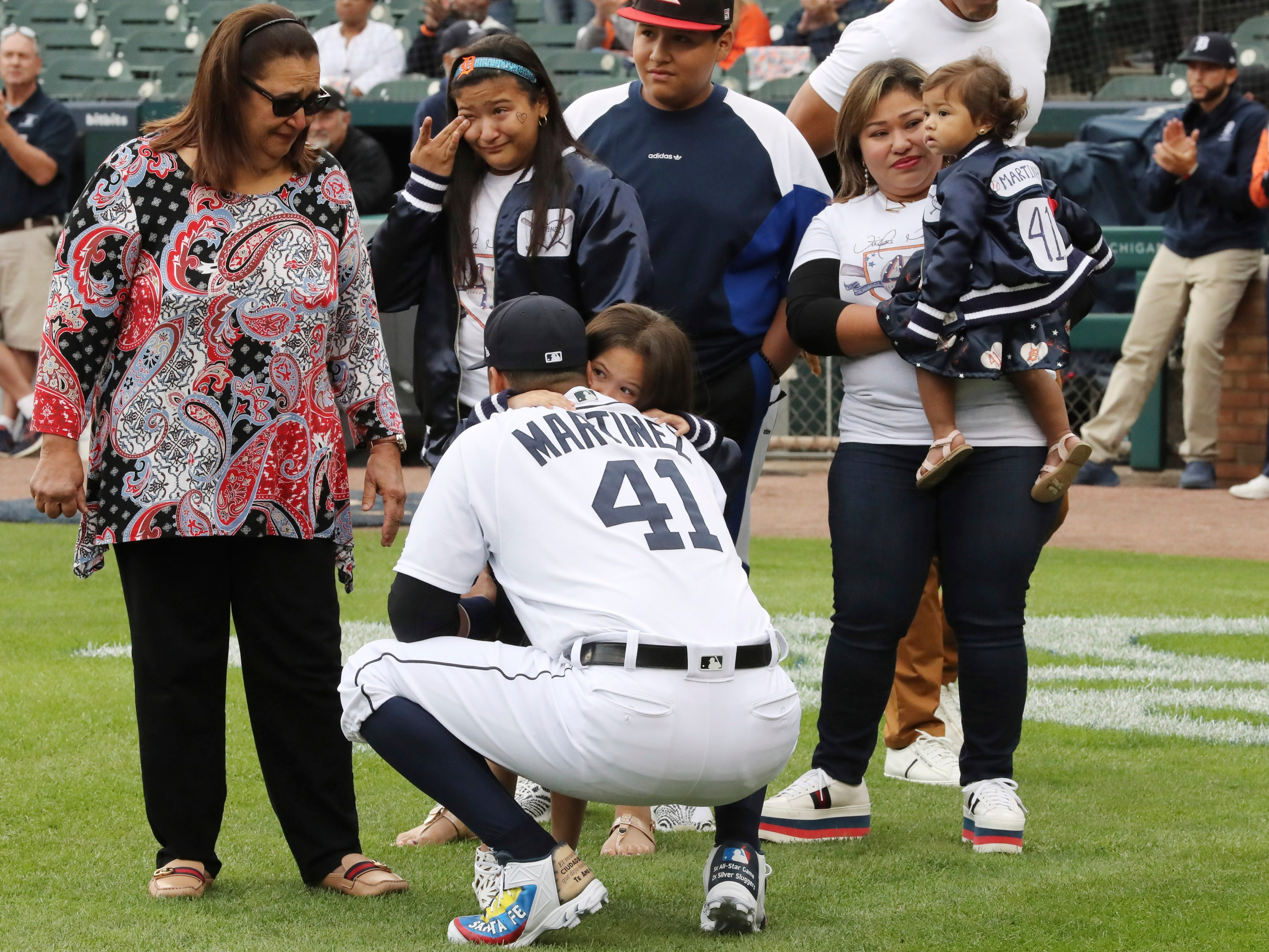 Tigers designated hitter Victor Martinez hugs a family member before the game against the Royals on Saturday, Sept. 22, 2018, at Comerica park Martinez is playing his final game Saturday and said he wants his final at-bats to be in front of the home fans.