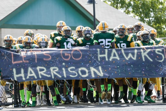 Farmington Hills Harrison players get ready before a game against Rochester Hills Stoney Creek at Harrison High School in Farmington Hills, Friday, September 21, 2018.