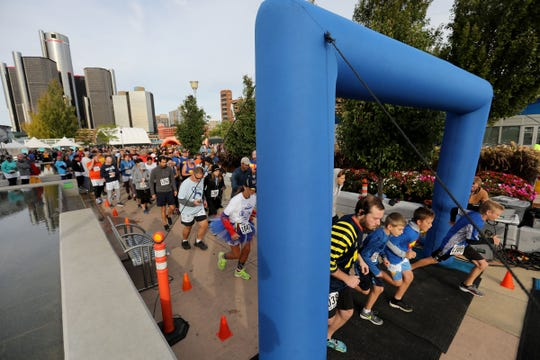 Participants cross the starting line at the 2018 Detroit Undy RunWalk on the Detroit Riverwalk on Saturday, Sept. 22, 2018.