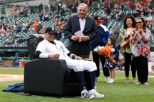 Sep 22, 2018; Detroit, MI, USA; Detroit Tigers first baseman Victor Martinez (41) smiles as he sits on his new chair near general manager Al Avila during his retirement ceremony before the game against the Kansas City Royals at Comerica Park. Mandatory Credit: Raj Mehta-USA TODAY Sports