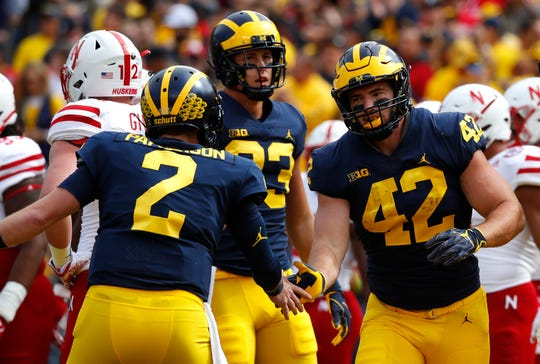 Ben Mason (42) celebrates his touchdown with Shea Patterson against Nebraska.