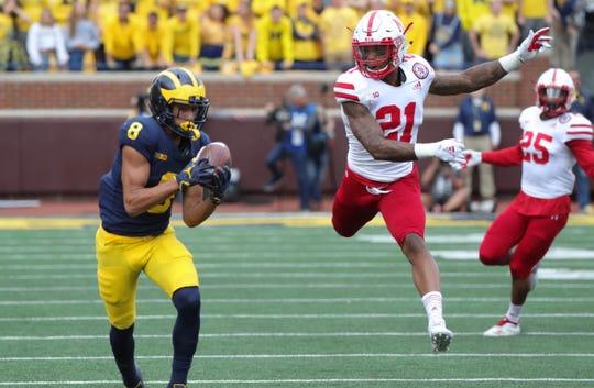 Michigan receiver Ronnie Bell catches a pass against Nebraska defensive back Lamar Jackson on Saturday, Sept. 22, 2018 at Michigan Stadium in Ann Arbor.