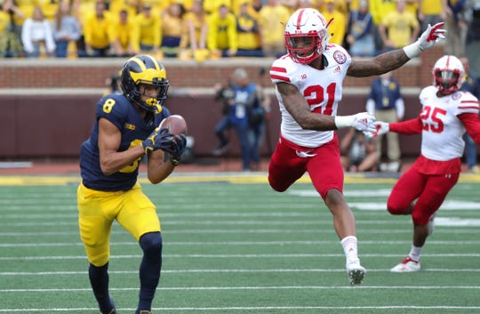 Michigan receiver Ronnie Bell catches a pass against Nebraska defensive back Lamar Jackson on Saturday, Sept. 22, 2018 at Michigan Stadium in Ann Arbor.