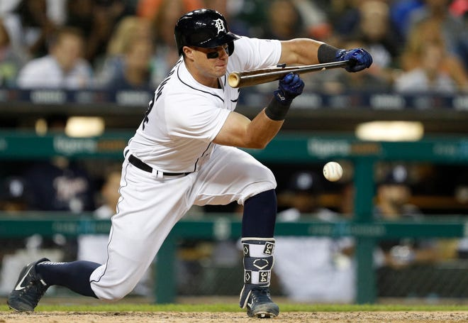 Detroit Tigers catcher James McCann bunts the ball during the ninth inning against the Kansas City Royals at Comerica Park on Sept. 21, 2018.