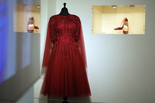 "The dress and shoes worn by Aretha Franklin on the first day of visitation is seen during a preview of the new exhibit about Aretha Franklin's life, ""Think: A Tribute to the Queen of Soul"", at the Charles H. Wright Museum of African American History in Detroit on Friday, Sept. 21, 2018."