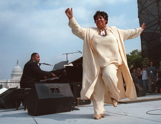 Aretha Franklin dances on stage during the first annual march on cancer in Sept. 1998 in Washington.
