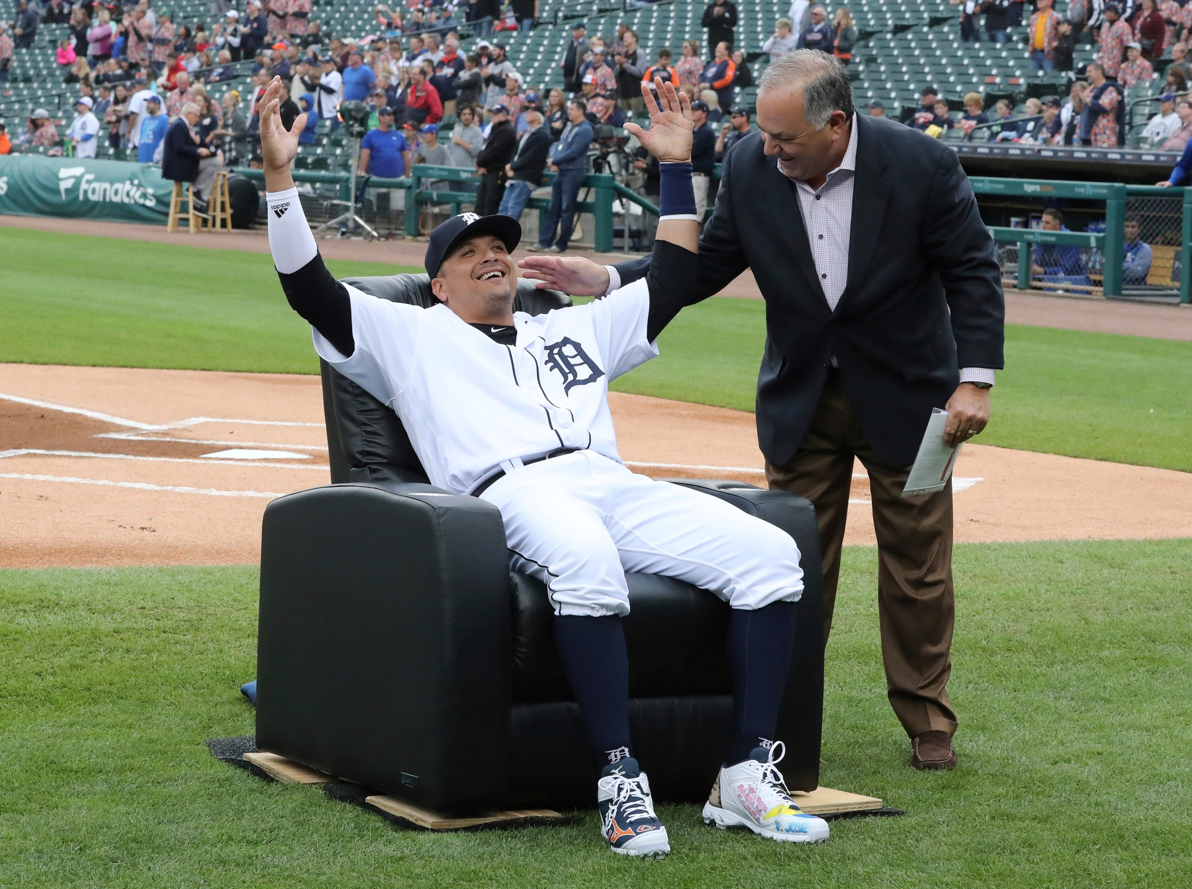 Tigers designated hitter Victor Martinez is presented a chair by general manager Al Avila before the Tigers' game against the Kansas City Royals on Saturday, Sept. 22, 2018, at Comerica Park. Martinez is playing his final game, and said he wants his final at-bats to be in front of the home fans.