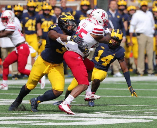 Michigan defenders Rashan Gary, left, and Josh Metellus tackle Nebraska running back Greg Bell during the first half on Saturday, Sept. 22, 2018, at Michigan Stadium.