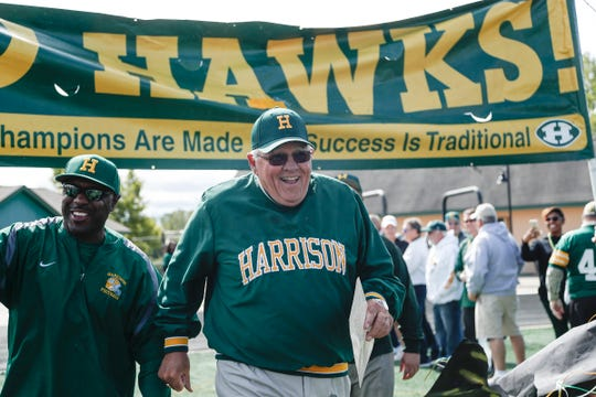 Farmington Hills Harrison head coach John Herrington walks down the field before a game against Rochester Hills Stoney Creek at Harrison High School in Farmington Hills, Friday, September 21, 2018.