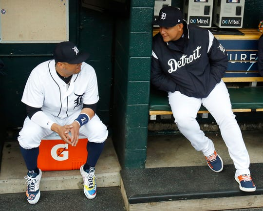 Tigers DH Victor Martinez and first baseman Miguel Cabrera chat before a ceremony honoring Martinez, who is playing his last game, at Comerica Park on Saturday, Sept. 22, 2018.