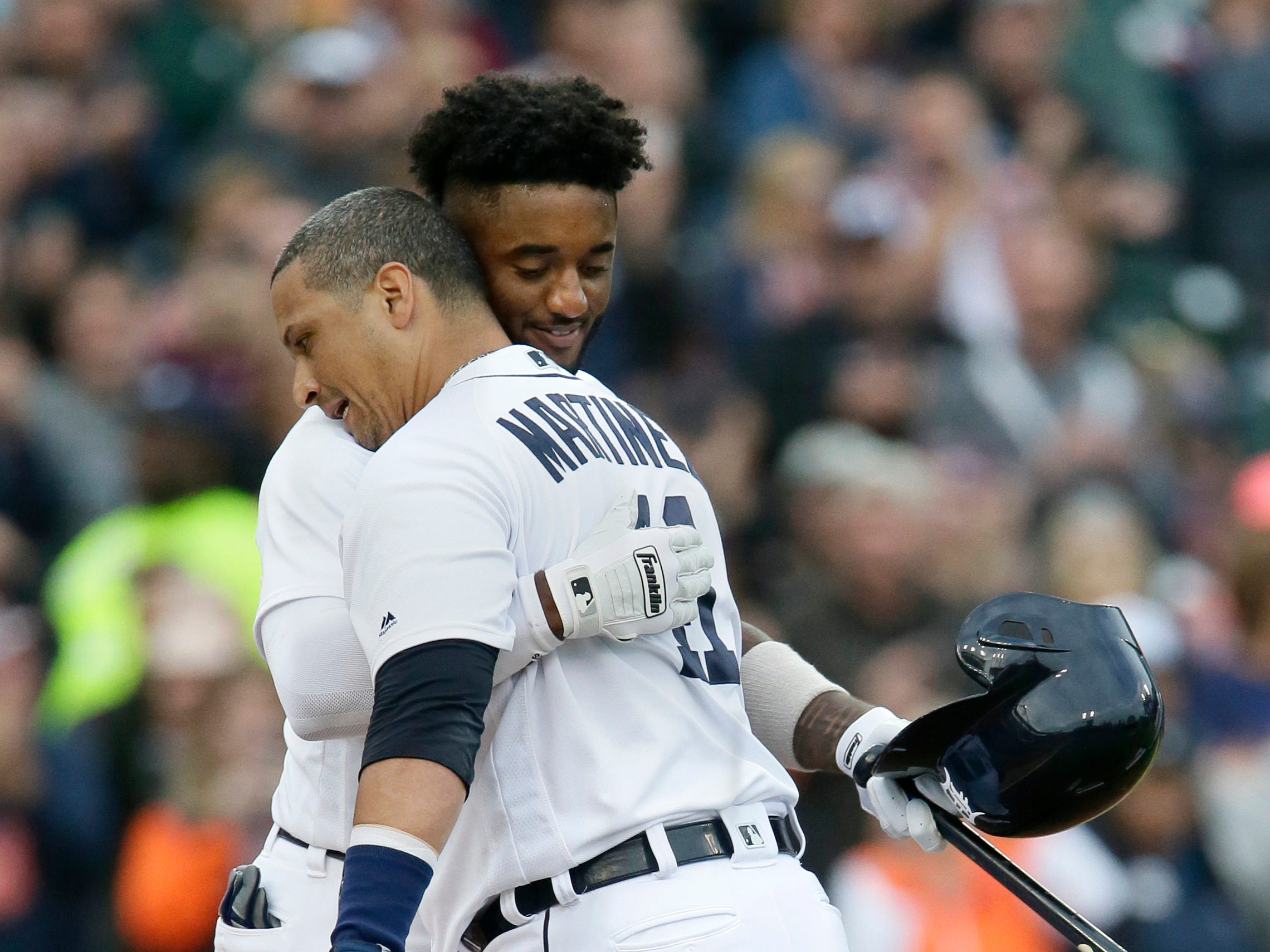 Detroit Tigers' Victor Martinez and Niko Goodrum embrace as Martinez leaves the game for a pinch-runner after hitting a single during the first inning of his final MLB game Sept. 22, 2018 in Detroit.