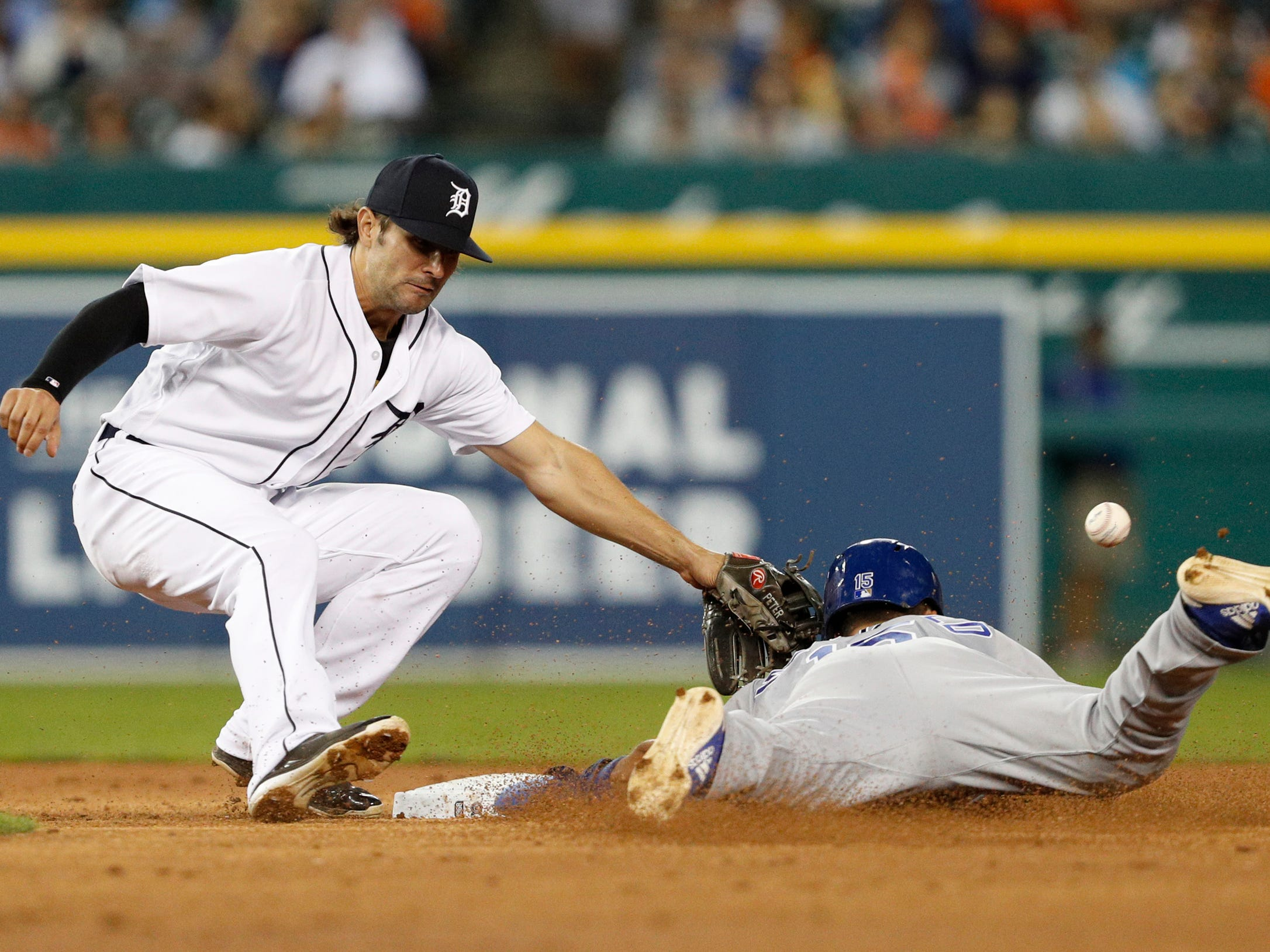 Kansas City Royals second baseman Whit Merrifield slides safe into second base against Detroit Tigers shortstop Pete Kozma during the third inning at Comerica Park on Sept. 21, 2018.