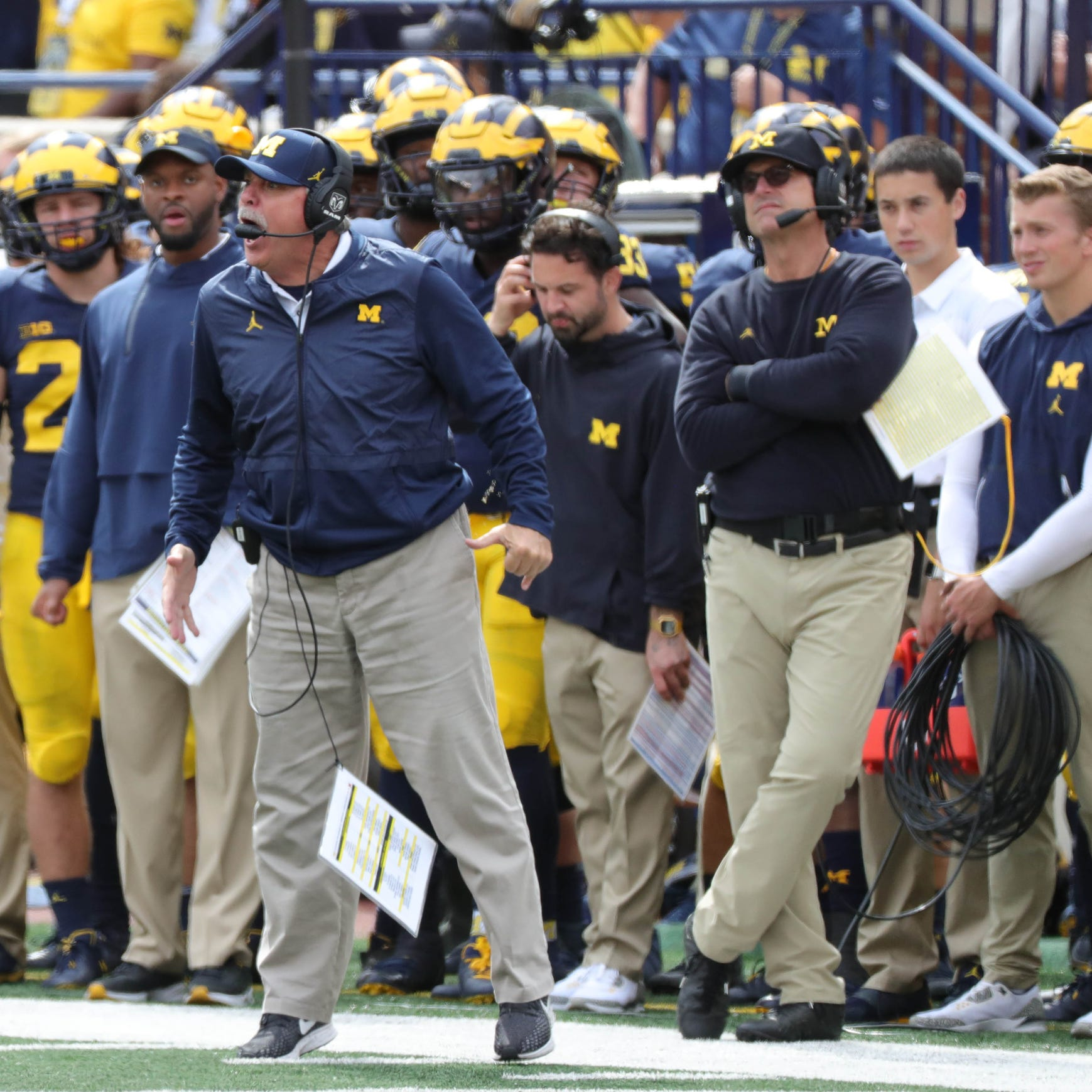 Michigan defensive coordinator Don Brown, left, and head coach Jim Harbaugh on the sideline against Nebraska on Saturday, Sept. 22, 2018 at Michigan Stadium in Ann Arbor.