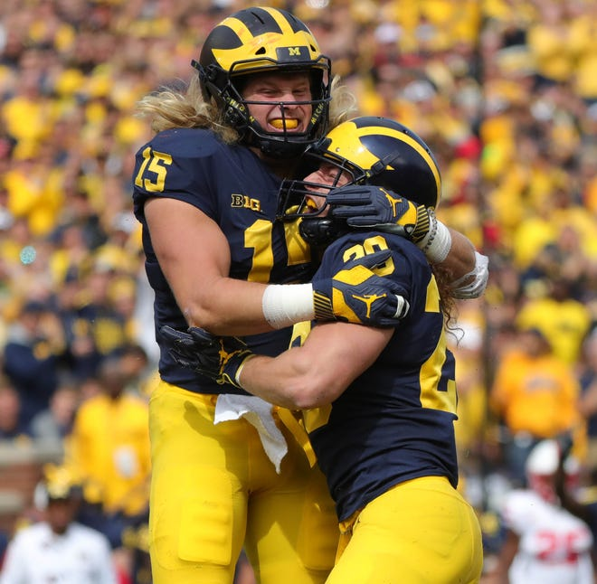 Michigan defenders Chase Winovich, left, and Jordan Glasgow celebrate after sacking Nebraska quarterback Adrian Martinez during the first half on Saturday, Sept. 22, 2018, at Michigan Stadium.