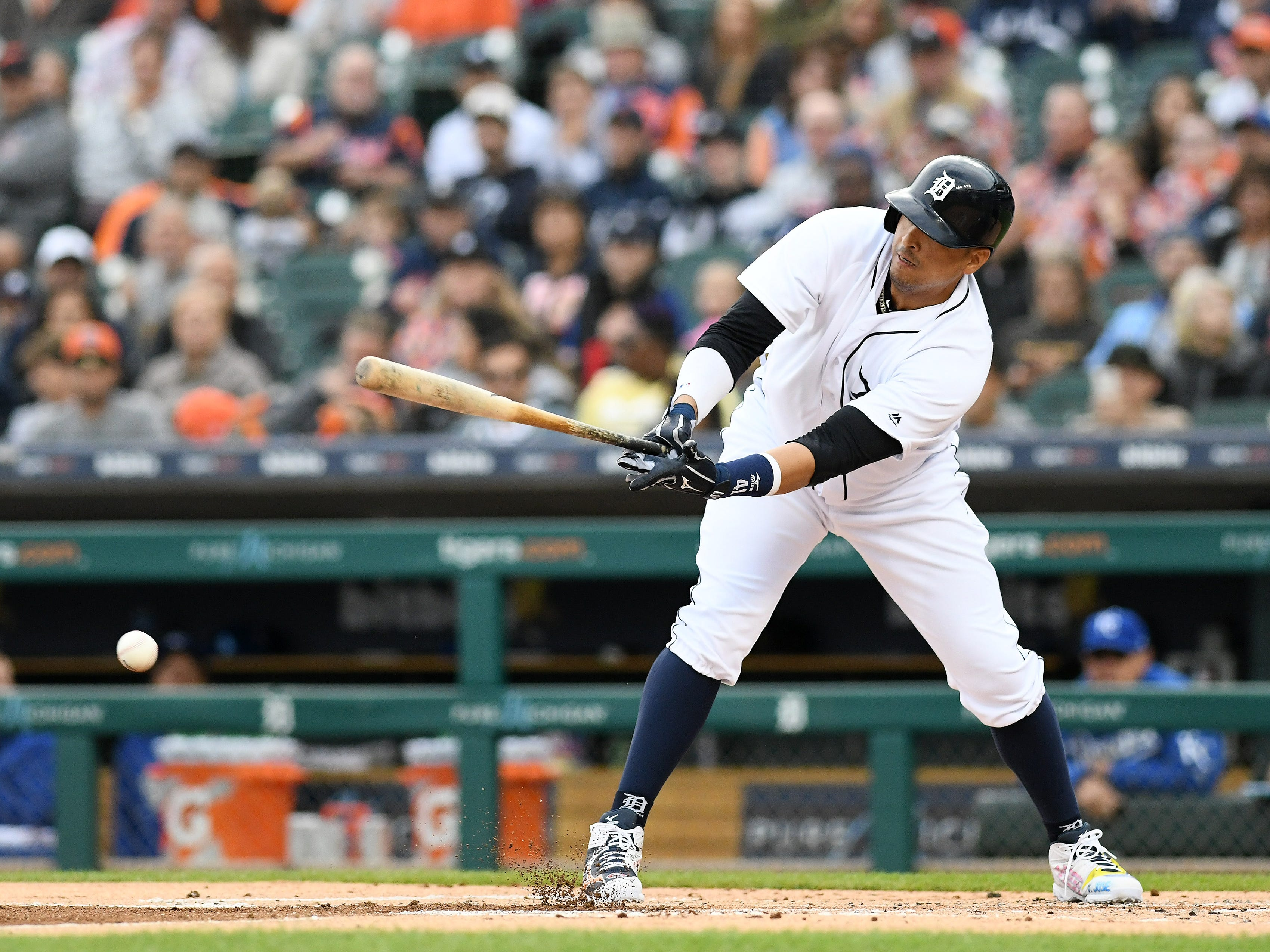 Tigers' Victor Martinez singles in the first inning for the final bat of his career.