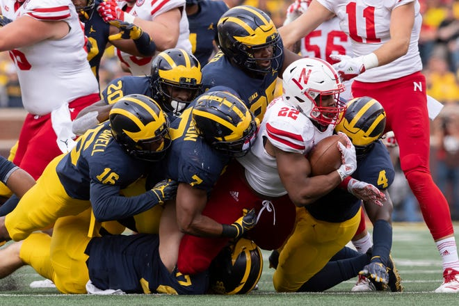 Nebraska running back Devine Ozigbo is tackled by the Michigan defense in the fourth quarter.