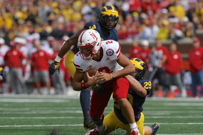 Michigan linebacker Jordan Glasgow sacks Nebraska's Adrian Martinez during the first half on Saturday.