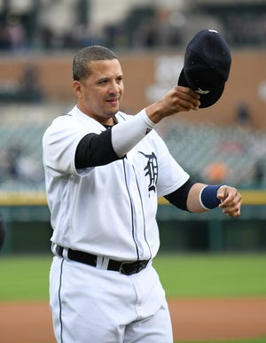 Victor Martinez salutes the fans during a special tribute ceremony Saturday at Comerica Park.