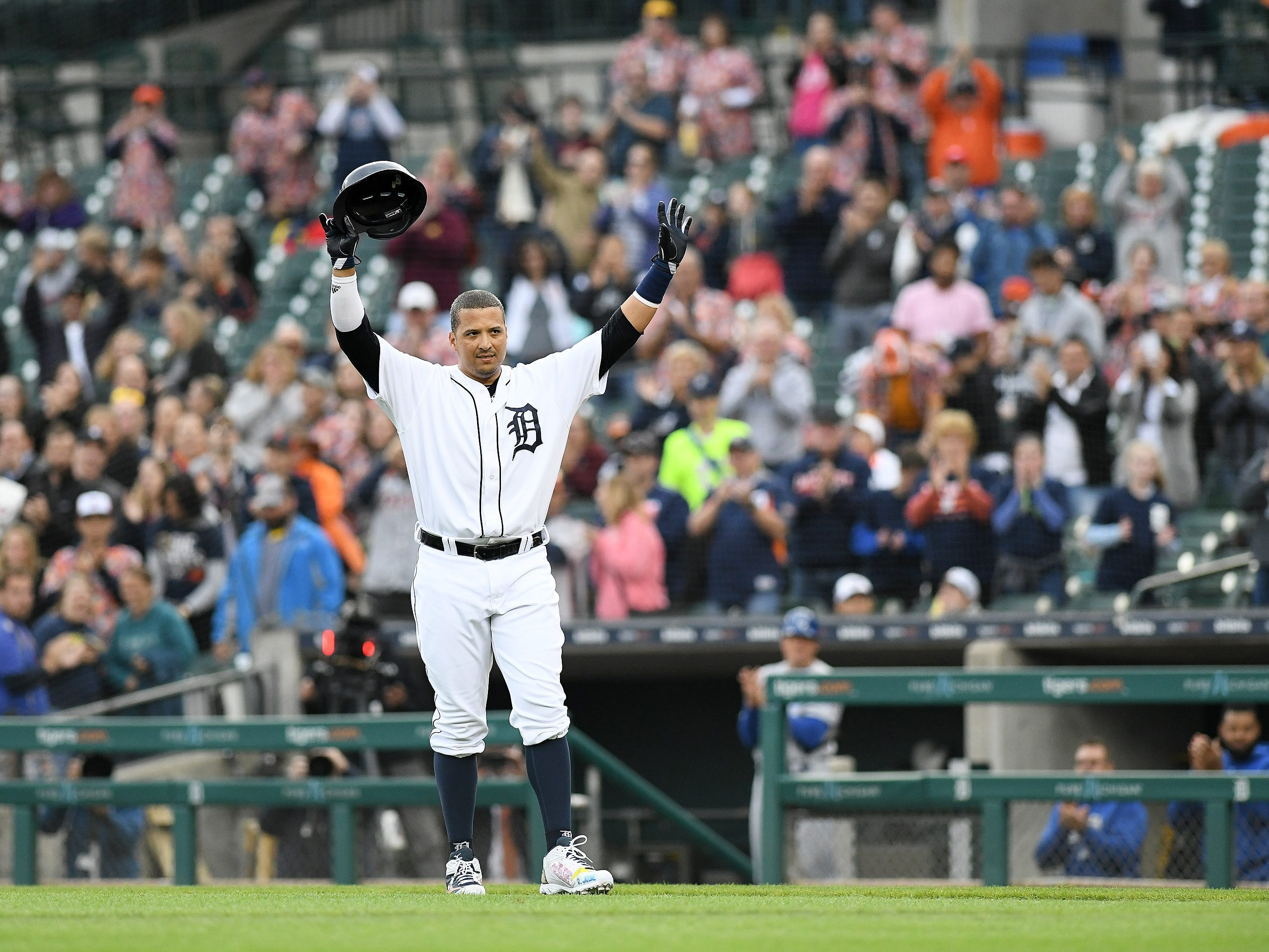 Tigers' Victor Martinez acknowledges the crowd as he comes out of the game for a pinch runner in the first inning.