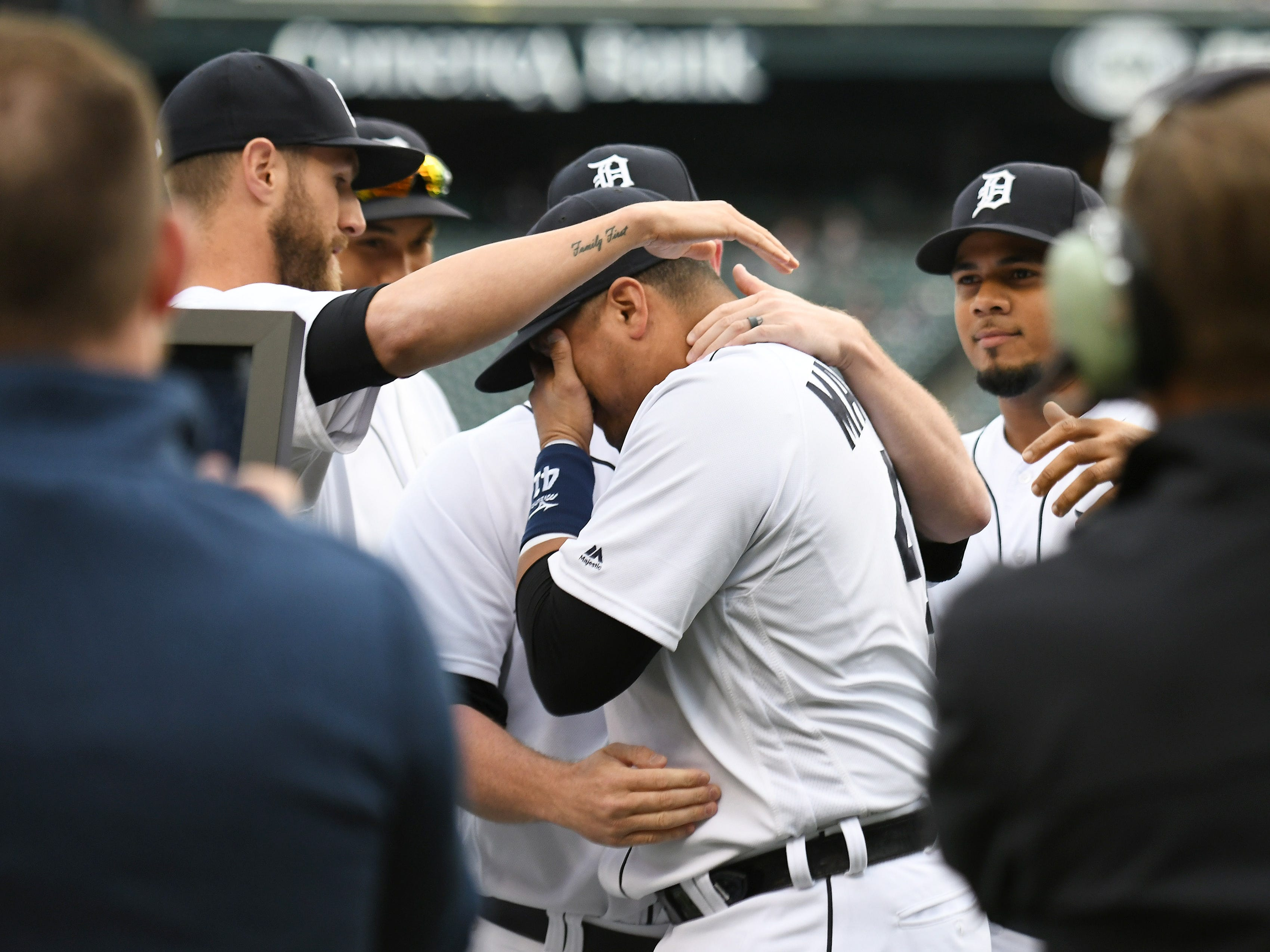 Tigers players gather around Victor Martinez after the special tribute ceremony.