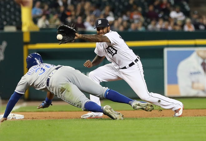 Tigers third baseman Ronny Rodriguez, right, waits on the throw from catcher James McCann to tag out Kansas City Royals' Jorge Bonifacio during the fourth inning on Friday.