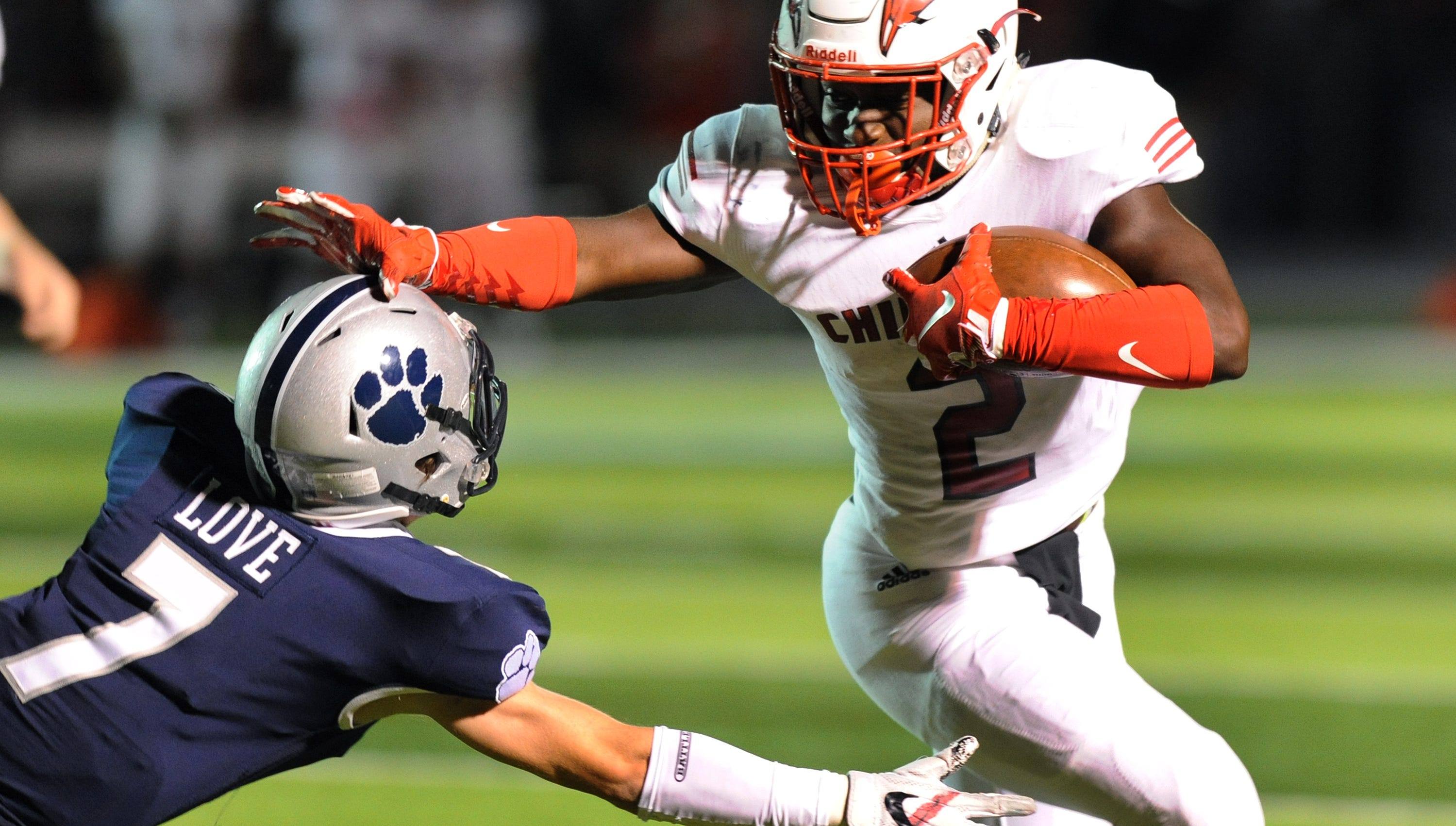 Chippewa Valley running back Ja'Von Kimpson (2), right, rushes past Macomb Dakota defensive back Matt Love (7) for a touchdown in the fourth quarter, Friday, Sept. 21, 2018, at Dakota HS in Macomb, Mich.  Chippewa Valley defeated Dakota, 24-17.